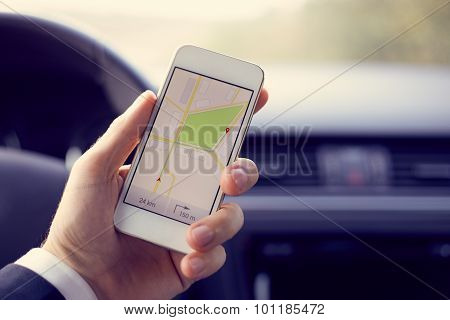 Man Holding White Mobile Phone With Map Gps Navigation, Toned