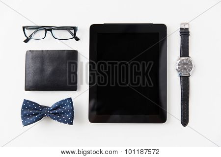 hipster personal stuff and objects concept - tablet pc computer, wallet, eyeglasses, bowtie and wristwatch on table