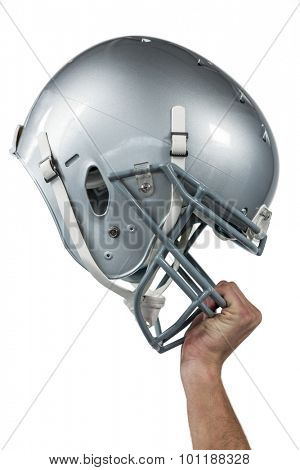 Close-up of American football player handing his sliver helmet on white background