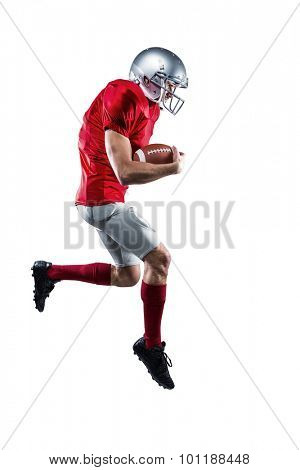 Full length of American football player holding ball while running against white background