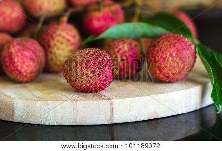 Lychee fruit on a wooden board