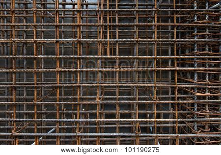 Steel bars reinforcement on construction site, vertical wall, editable background.
