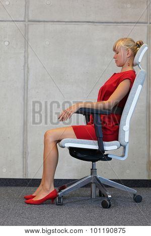 Woman testing office chair making herself comfortable