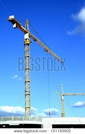 The crane on the building.