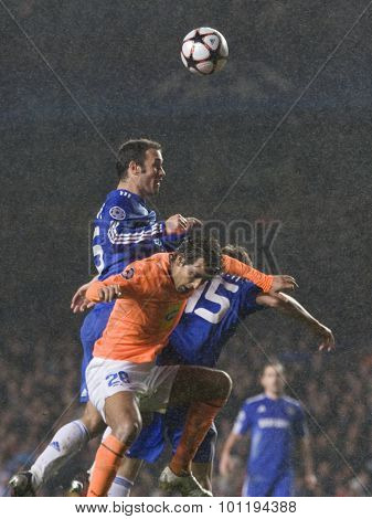LONDON, ENGLAND. 08 December 2009. - Ricardo Carvalho playing for Chelsea leaps to head the ball during the Uefa Champions League match, between Chelsea and Apoel Nicosia at Stamford Bridge.