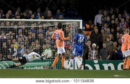 LONDON, ENGLAND. 08 December 2009. - Nuno Morais and Gael Kakuta  watch the ball go into the Apoel goal scored by Michael Essien playing for Chelsea during the Uefa Champions League match