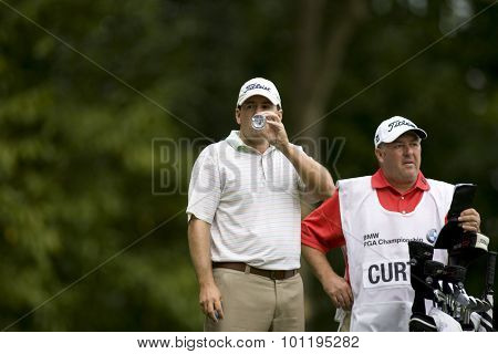WENTWORTH, ENGLAND. 23 MAY 2009.Ben Curtis (USA) takes a quick drink playing in the 3rd round of the European Tour BMW PGA Championship.