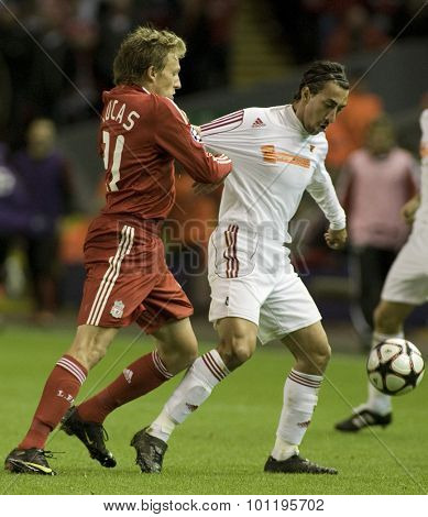 LIVERPOOL ENGLAND. 16 SEPTEMBER 2009. Lucas Leiva playing for Liverpool pulls the shirt of Leandro playing for Debreceni VSC during the Champions League match between Liverpool FC and Debreceni VSC