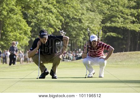 WENTWORTH, ENGLAND. 24 MAY 2009.Ross Fisher (GBR) and Rory Mcilroy (GBR) line up putts playing in the final round of the European Tour BMW PGA Championship.