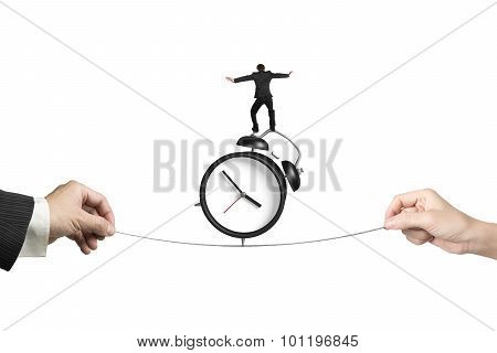 Two Hands Pulling Rope Businessman Balancing On Alarm Clock
