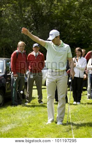 WENTWORTH, ENGLAND. 21 MAY 2009.Scott STRANGE AUS takes a drop ball after his ball landed under a car in the carpark playing in the European Tour BMW PGA Championship.