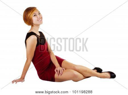 Smiling Asian American Woman Sitting On Floor