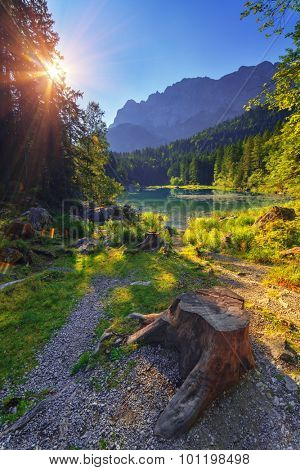 Fantastic sunrise on mountain lake Eibsee, located in the Bavaria, Germany. Dramatic unusual scene. Alps, Europe.