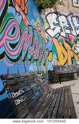 Two Benches Sprayed With Graffiti