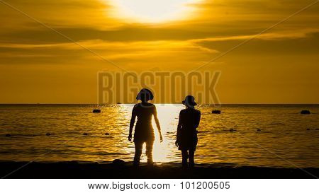 Happy Woman Silhouette Standing Against Sunset With Arms Raised Up, Chonburi,thailand