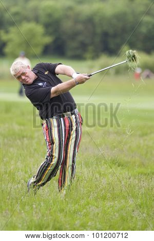 KENT ENGLAND, 27 MAY 2009. John DALY (USA) playing a shot from the rough playing in the first round of the European Tour European Open golf tournament.