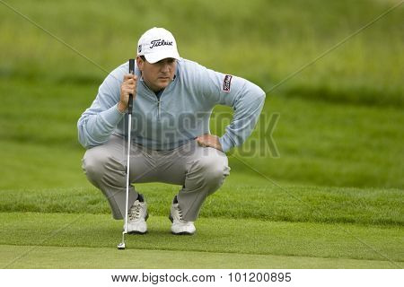 KENT ENGLAND, 27 MAY 2009. Ben CURTIS (USA) lines up a putt playing in the first round of the European Tour European Open golf tournament.