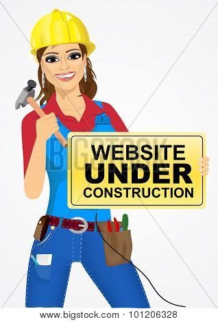 builder woman with hammer