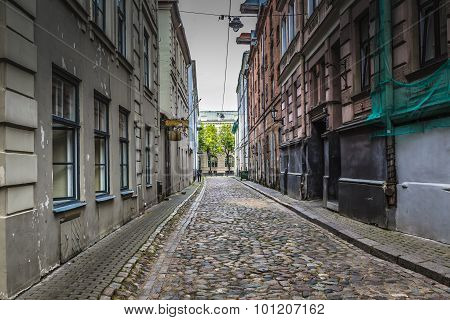 Morning Street In Medieval Town Of Old Riga City, Latvia. Walking Through Medieval Streets Of Old Ri