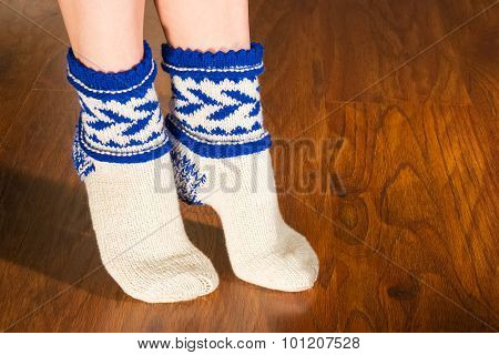 Feet Warm Beautiful Socks On A Wooden Floor