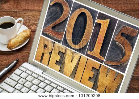 2015 review - annual review or summary of the recent year - text in letterpress wood type blocks on a laptop screen with a cup of coffee