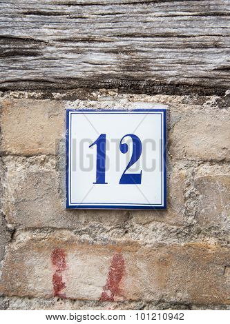 Number Twelve On The Grey Stone Wall