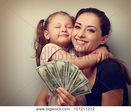Smiling Mother And Happy Cute Daughter Cuddling And Showing Dollars. Happy Winning Family. Vintage P