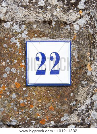 Number Twenty Two On The Grey Stone Wall