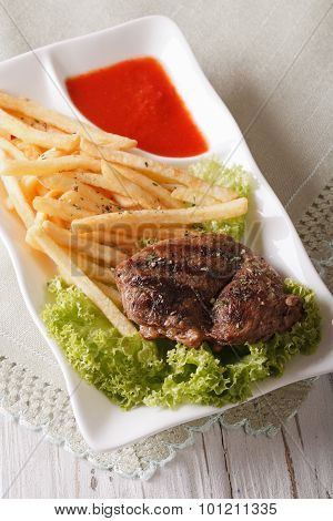 Fried Potatoes And Grilled Beefsteak With Ketchup Close-up. Vertical