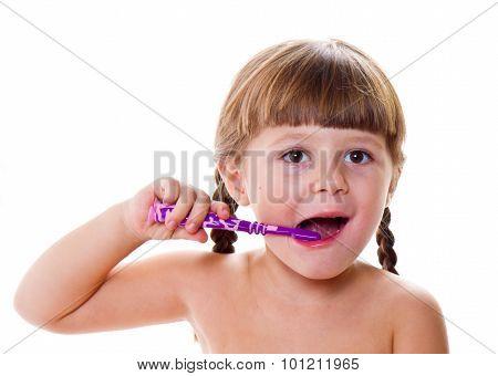 Dental Hygiene. Happy Little Girl Brushing Her Teeth