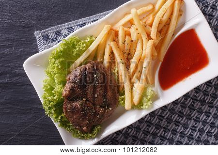 Serving Grilled Beefsteak With French Fries Closeup. Horizontal Top View