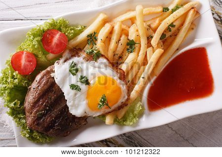 Beefsteak, Fried Egg And Potatoes On A Plate Closeup. Horizontal Top View
