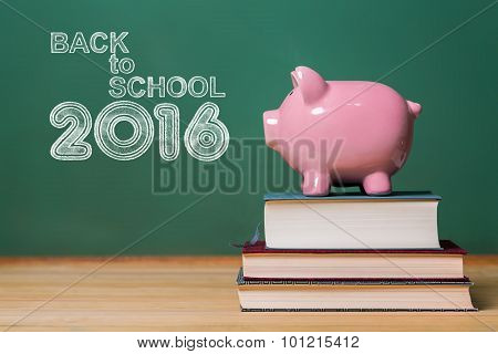 Back To School 2016 Text With Pink Piggy Bank On Top Of Books