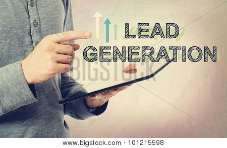 Young Man Pointing At Lead Generation Text Over Tablet Computer