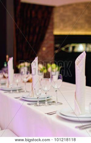 Table set for an elegant dinner in a restaurant