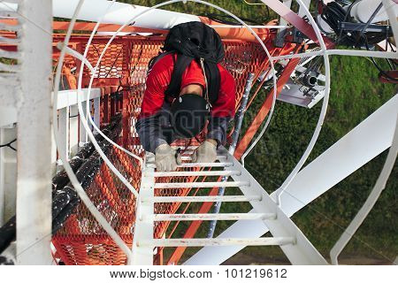 Industrial climber down from telecommunications tower