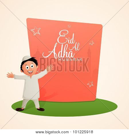 Cute little Islamic boy celebrating and enjoying on occasion of Muslim Community Festival of Sacrifice, Eid-Al-Adha Mubarak.