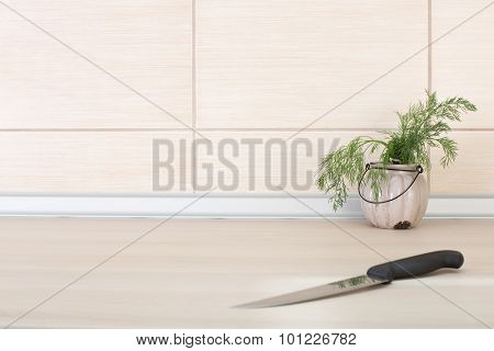 Dill In Pot And Knife On The Countertop