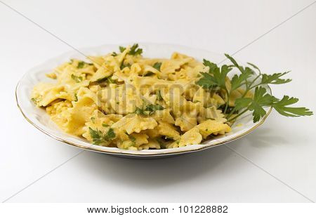 Farfalle pasta with white fish souce shot over gray background