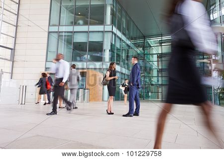People passing through the busy foyer of a business building