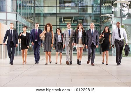 Large group of business people in lobby of a big business