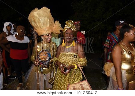 Women in gilded costumes