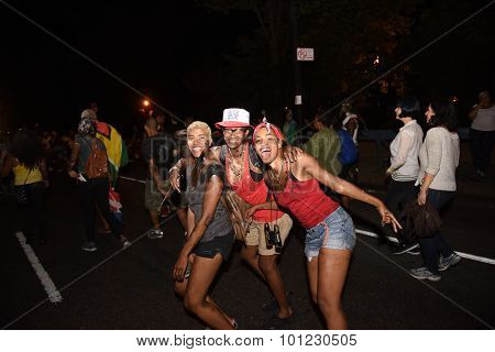 Revelers pose on Flatbush Avenue