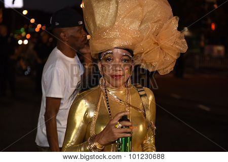 Older woman in gilded costume