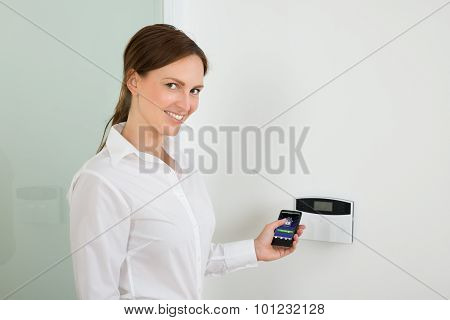 Businesswoman Operating Entrance Security System