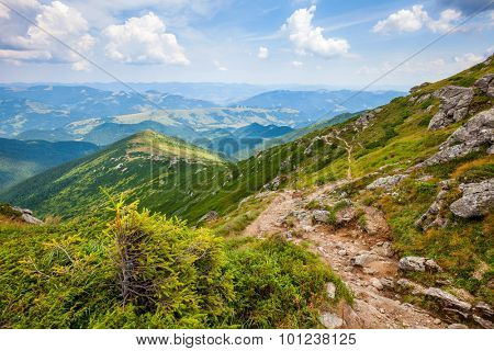 Landscape with Carpathian mountains track and sky clouds