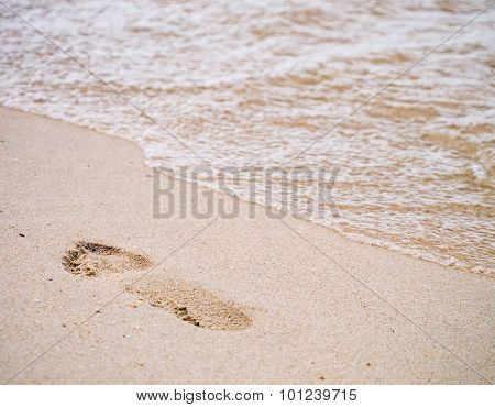 Human Footprint On The Beach