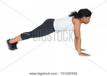 Fit woman doing push up on white background
