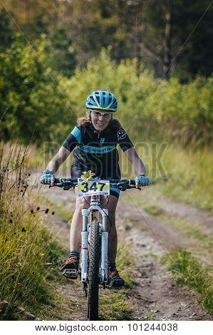 girl racer on bike rides on trail