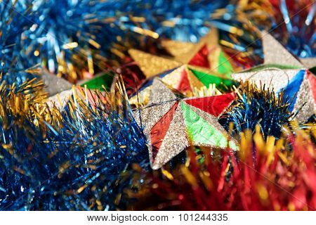 Christmas stars in multicolored tinsel